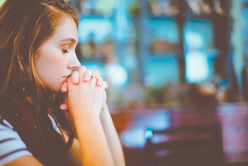 11 praying girl